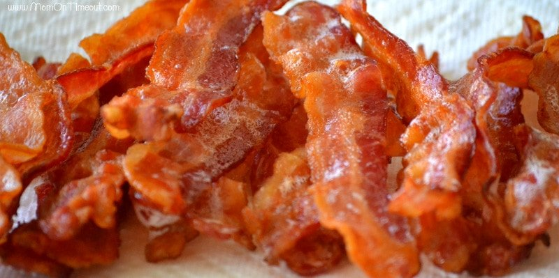 baked bacon on a paper towel