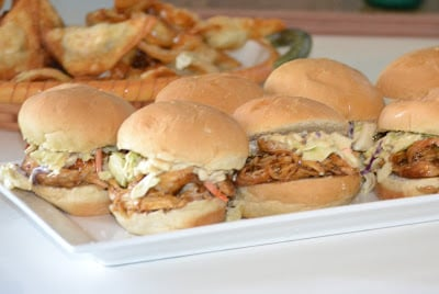 chicken sliders with coleslaw on white tray