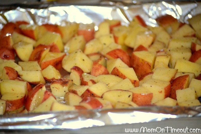 Roasted red potatoes on a foil lined baking sheet