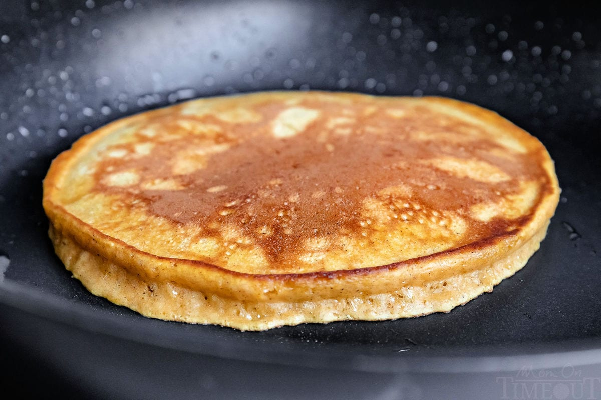 pumpkin pancakes being cooked on skillet