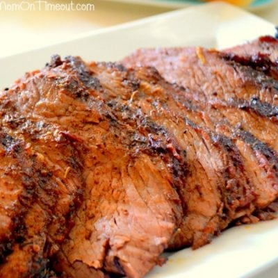 beef tri tip sliced on white plate
