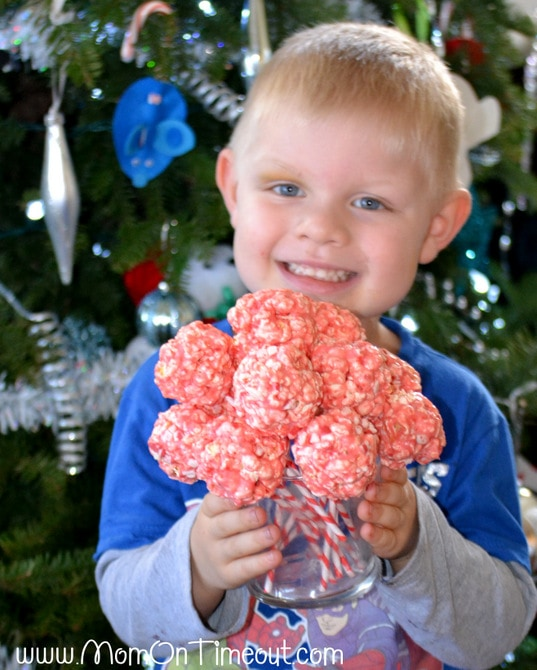 Marshmallow Peppermint Crunch Popcorn Ball Pops | MomOnTimeout.com
