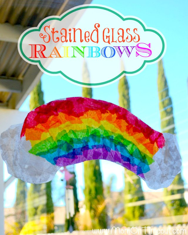 Rainbow glass craft using with a rainbow made from ripped up white, red, orange, yellow, green, light blue, dark blue, and purple tissue paper.