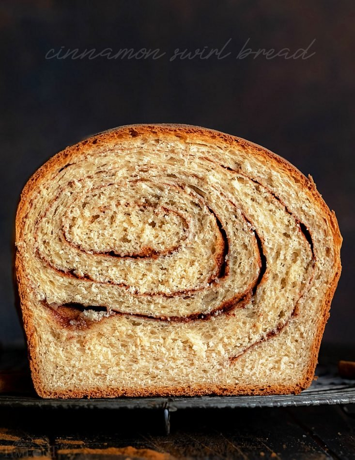 cinnamon bread recipe on rack slice cut