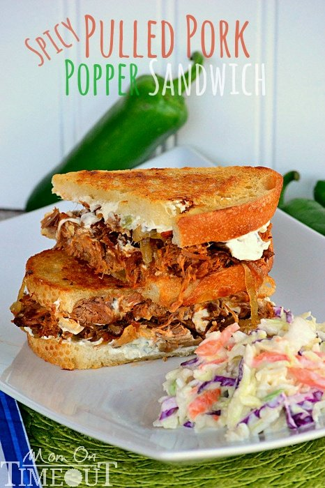 Spicy Pulled Pork Popper Sandwich | Mom On Timeout - Made with my favorite slow cooker pulled pork recipe, caramelized onions, and Spicy Jalapeño cream cheese - seriously good!
