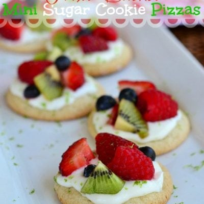 fruit basket sugar cookie pizzas on white tray with title overlay