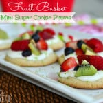 fruit basket sugar cookie pizzas on white tray with title overlay landscape view
