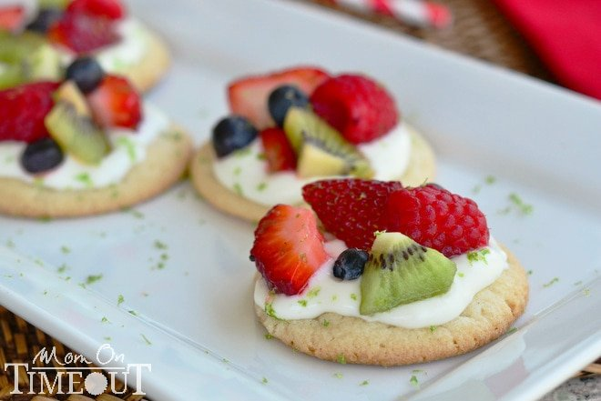Fruit Basket Mini Sugar Cookie Pizzas - A delicious lime flavored cream cheese frosting brings out the delicious flavors of the fresh fruit. Perfect for summer!  MomOnTimeout.com