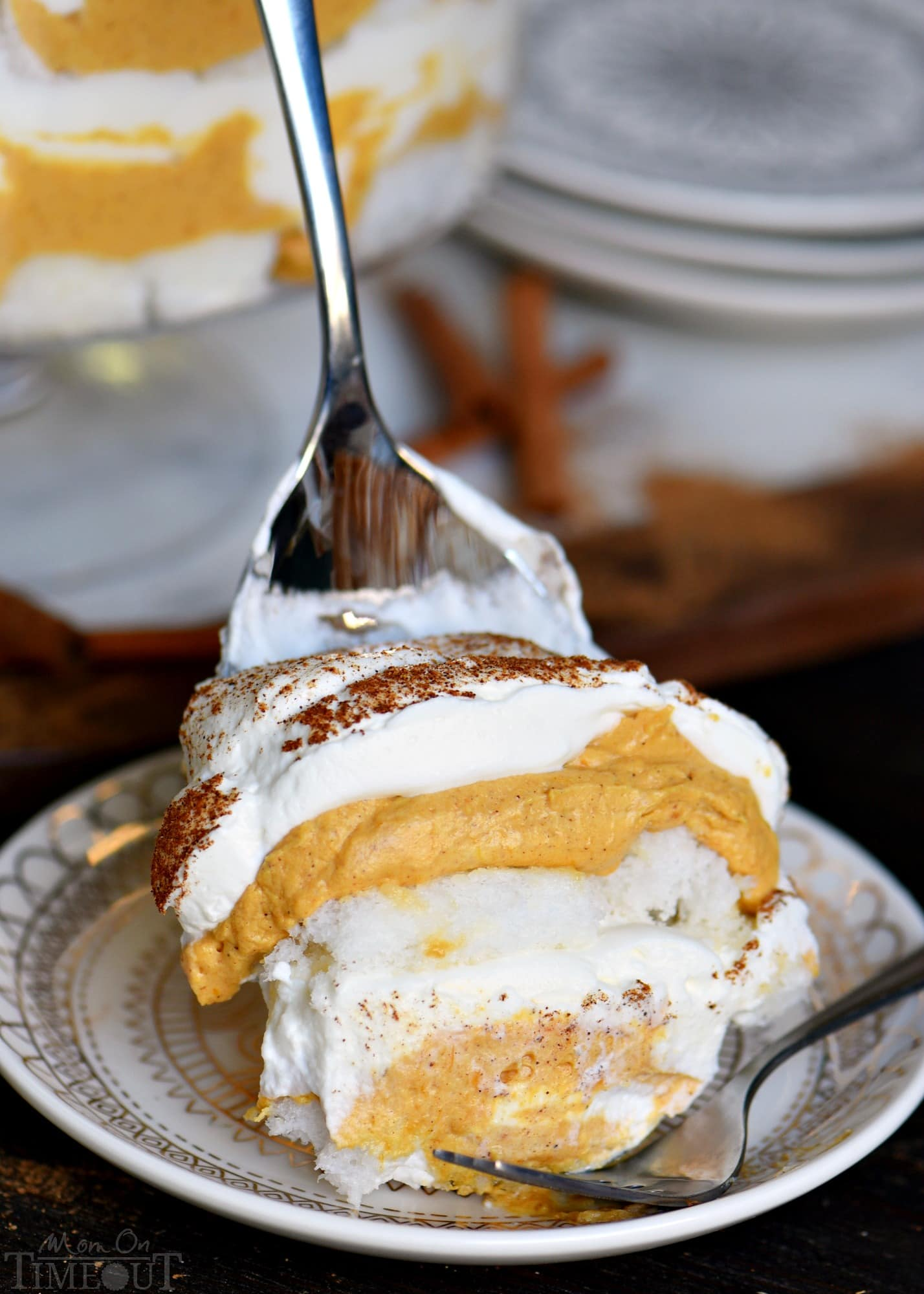This Pumpkin Cheesecake Trifle is sure to impress all season long! Layers of pumpkin cheesecake, whipped cream and angel food cake combine for a fall treat that's impossible to resist! Gorgeous, simple, and totally delicious! // Mom On Timeout