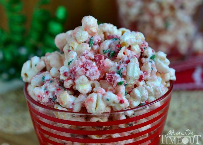 You're going to love the fabulous flavor and satisfying crunchy sweetness of this Peppermint Crunch Popcorn! It takes just minutes to prepare and would make the perfect gift this holiday season! Take this to your holiday party and let the compliments roll in! | MomOnTimeout.com | #popcorn #Christmas #recipe