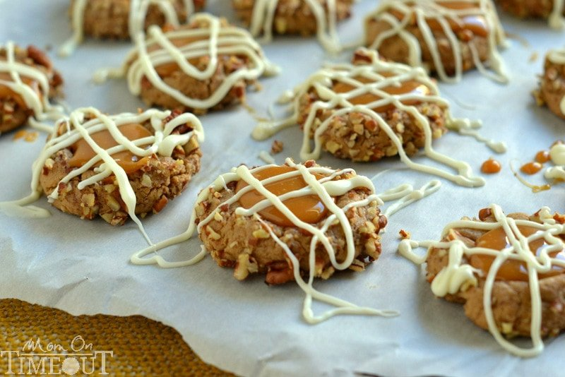 These Caramel Spice Thumbprint Cookies start with a spice cake mix and end with a white chocolate drizzle - cookie perfection!   MomOnTimeout.com