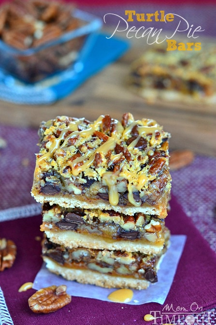 If you love pecan pie you're going to go crazy for these Turtle Pecan Pie Bars! Packed full of crunchy pecans, creamy caramel, and decadent chocolate, these bars are sure to satisfy your sweet tooth!   MomOnTimeout.com #sponsor #pie #turtle