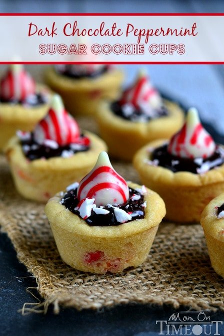 Dark Chocolate Peppermint Sugar Cookie Cups filled with chocolate ganache and topped with Candy Cane Hershey's Kisses.   MomOnTimeout.com #christmas #recipe