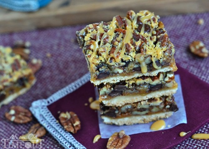 If you love pecan pie you're going to go crazy for these Turtle Pecan Pie Bars!  Packed full of crunchy pecans, creamy caramel, and decadent chocolate, these bars are sure to satisfy your sweet tooth! | MomOnTimeout.com #sponsor #pie #turtle