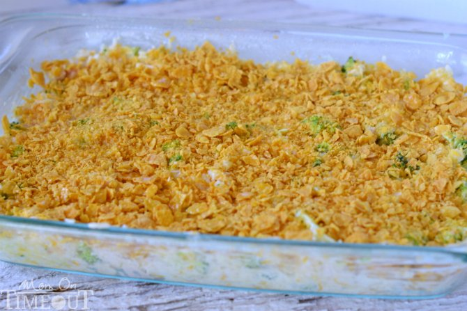 broccoli rice casserole with chicken and cheese in baking dish