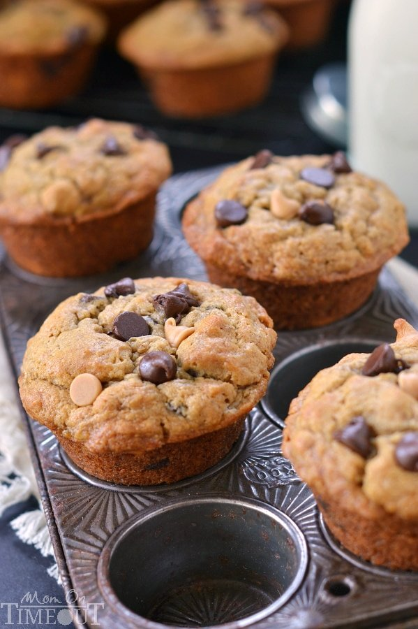 Incredibly moist and delicious Peanut Butter Banana Chocolate Chip Muffins packed with peanut butter flavor and sweet morsels of chocolate. For mornings when you just need a little chocolate. | MomOnTimeout.com | #recipe #breakfast
