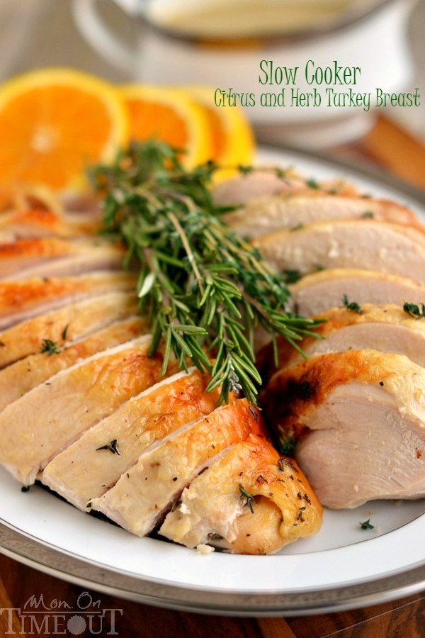 This Slow Cooker Citrus and Herb Turkey Breast is, hands down, the most amazing turkey you will ever eat! Juicy, tender, succulent and bursting with flavor, this recipe is a necessary addition to your holiday feast! | MomOnTimeout.com | #Thanksgiving #Chistmas
