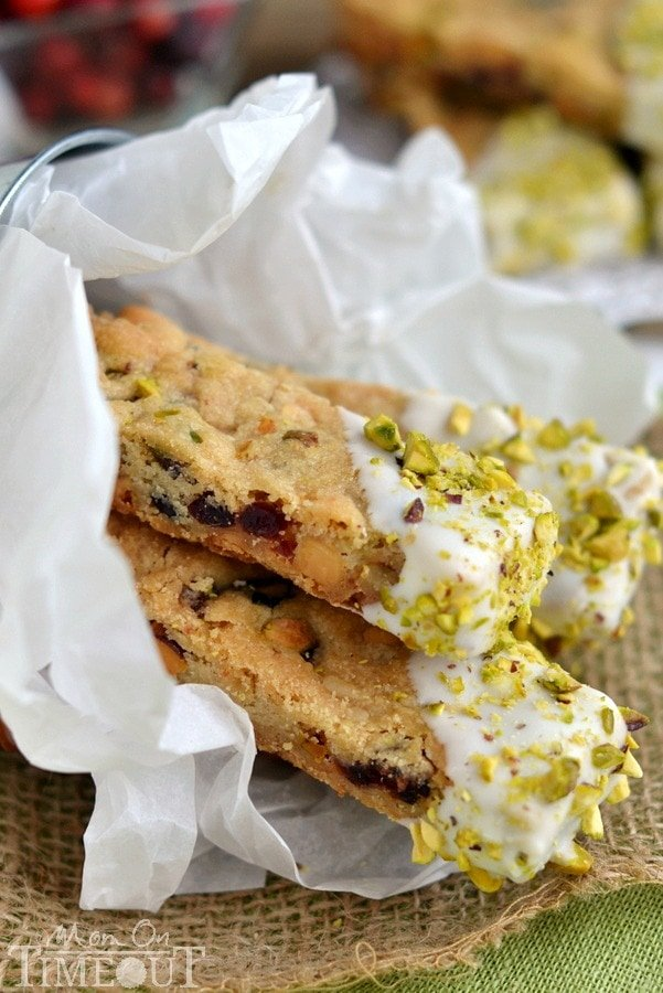 There's nothing prettier than this White Chocolate Cranberry Pistachio Shortbread! Easy to make, these shortbread sticks are perfect for cookie trays and gifts this holiday season! | MomOnTimeout.com | #recipe #cookies #cranberry #spon