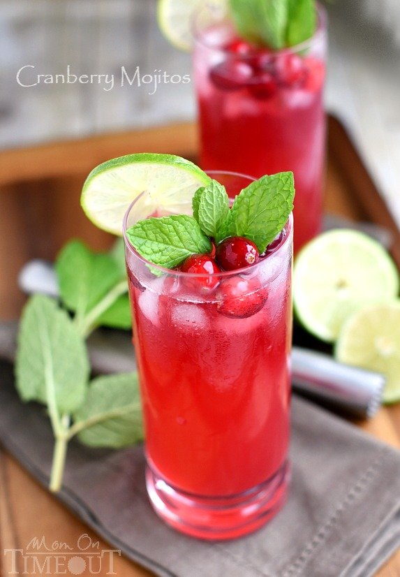 Cranberry Mojitos are perfect for any night but especially a celebration! Tart, sweet, refreshing, and delicious - everything a good cocktail should be. | MomOnTimeout.com | #cocktail #cranberry #beverage #recipe