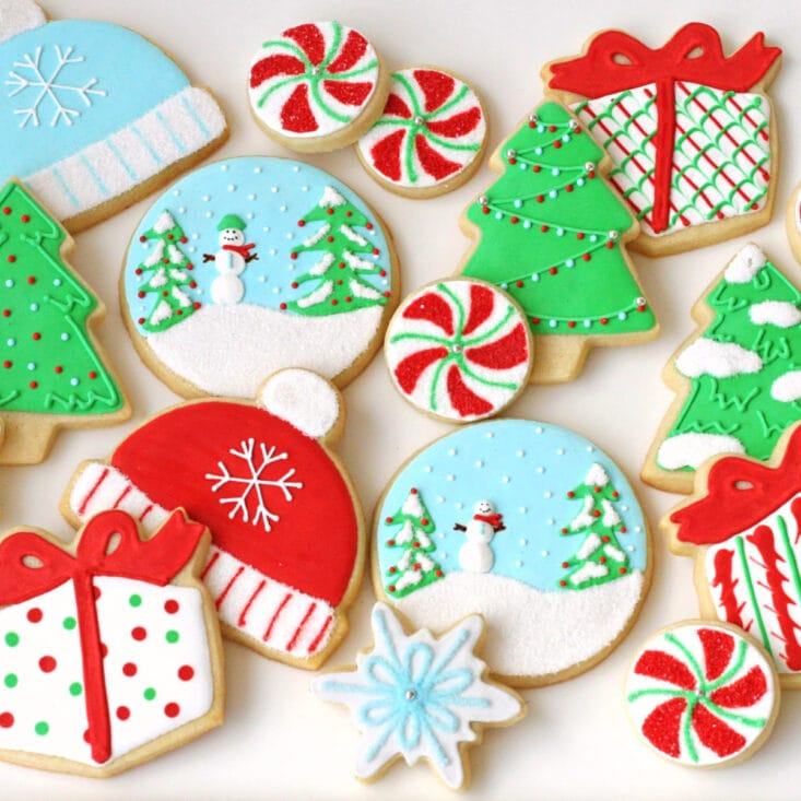 top down view of decorated sugar cookies on white surface