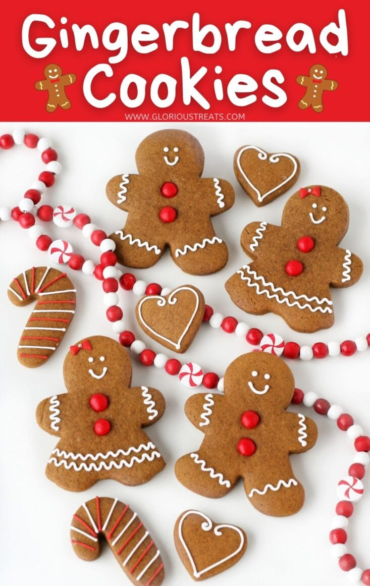 gingerbread cookies decorated simply laid out on white surface with title overlay at top glorious treats