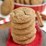ginger molasses cookies in a stack on red burlap sitting on brown napking