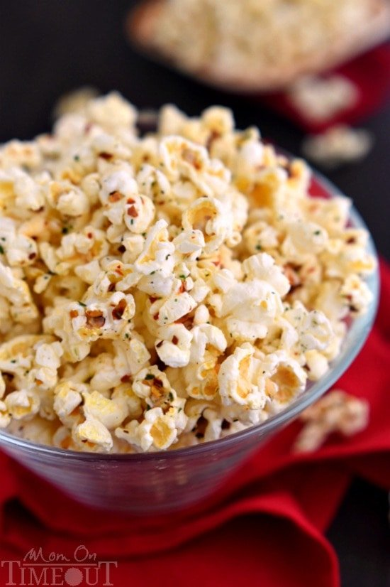 You're just 4 ingredients away from snacking paradise with this delicious Spicy Ranch Popcorn! So addicting, this delightfully easy recipe is sure to become a new family favorite!   MomOnTimeout.com   #appetizer #snack #recipe