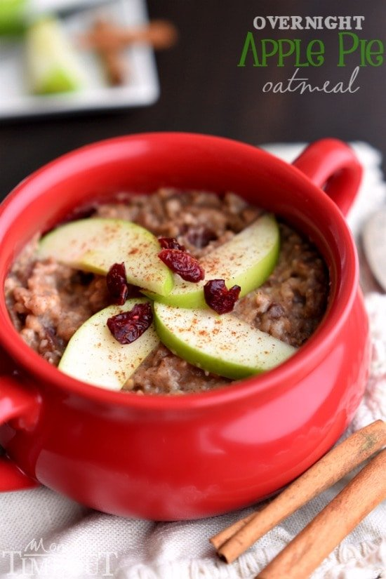 Take the stress out of your morning routine with this Overnight Slow Cooker Apple Pie Oatmeal! Made with steel-cut oats, apples, cranberries and spices! A perfectly delicious way to start your day! | MomOnTimeout.com | #breakfast #crockpot #recipe