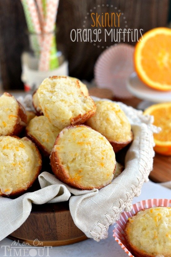 These Skinny Orange Muffins are made with Greek yogurt and plenty of orange zest for a terrific, bright orange flavor! So tender and moist, these muffins are a great way to start to your day! | MomOnTimeout.com | #breakfast #brunch #muffin #recipe #orange