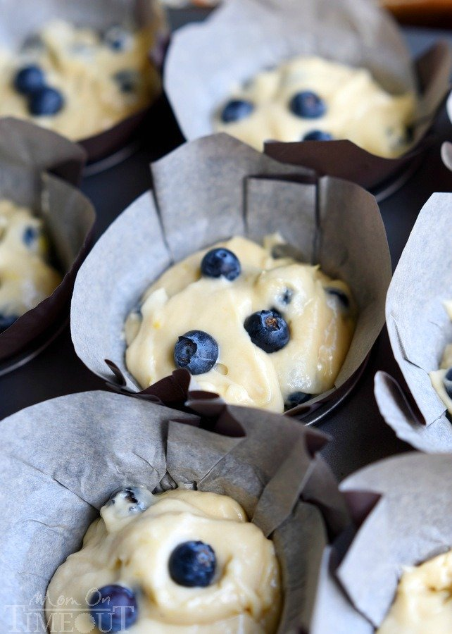 Blueberry Lemon Cream Cheese Muffins are the perfect way to start (or end) your day! An easy breakfast recipe that's sure to become a new favorite. Delicately moist and bursting with flavor, these muffins are topped with a refreshingly tart lemon glaze that's bound to make your mouth water.   MomOnTimeout.com   #IDelightIn10