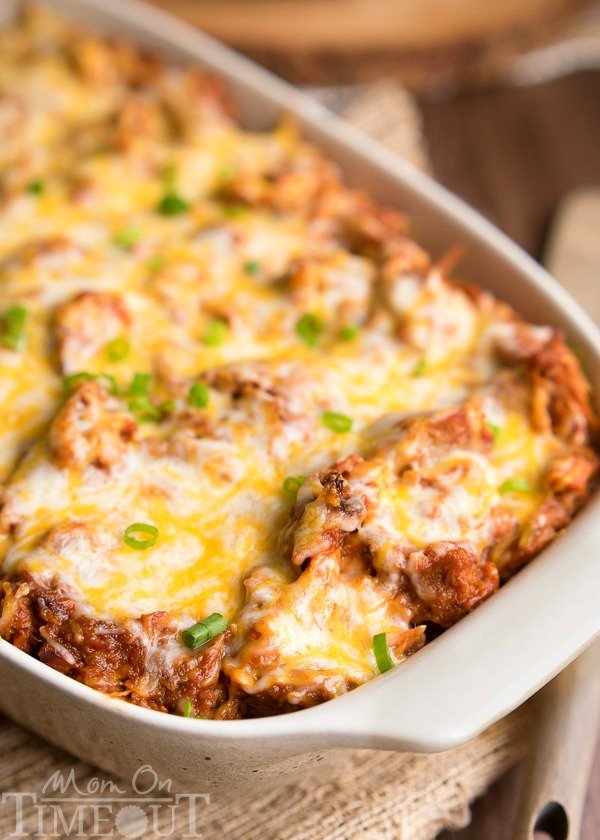 This crowd pleasing recipe is sure to be a hit at your next barbecue or picnic! This Loaded BBQ Pork Potato Casserole is so easy to make and crazy delicious. Comfort food at it's best! | MomOnTimeout.com