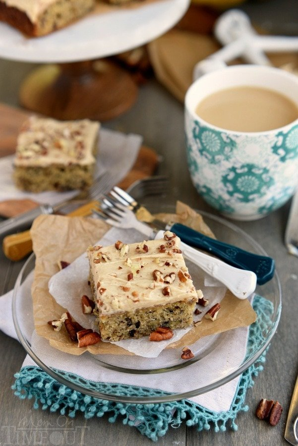 banana cake with coffee on plate and forks