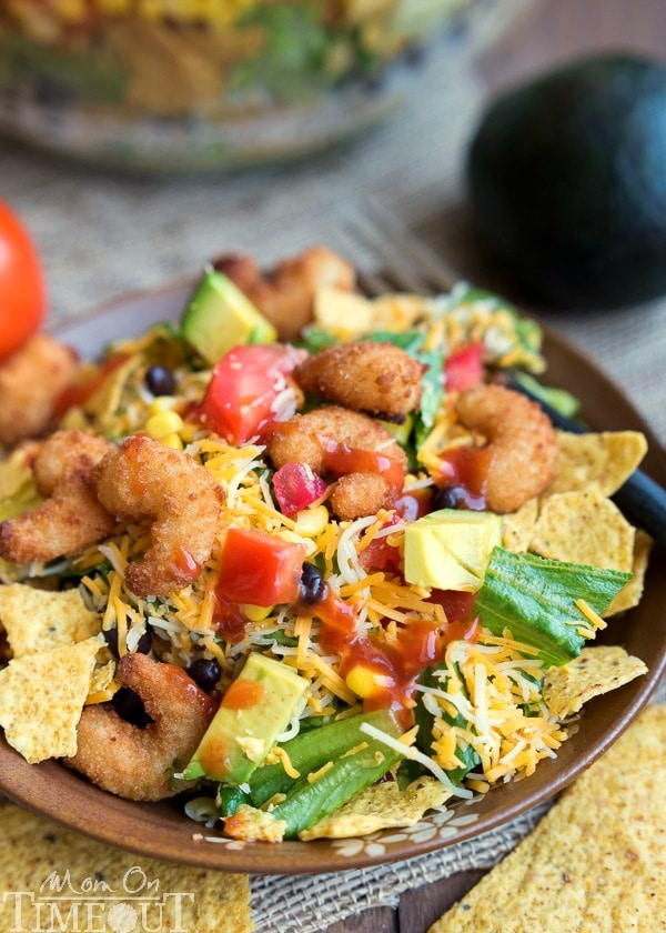 This easy Layered Popcorn Shrimp Taco Salad recipe is perfect for an easy, breezy summer time meal! Layers and layers of flavor make this a meal the whole family will love! | MomOnTimeout.com | #dinner #salad #ad
