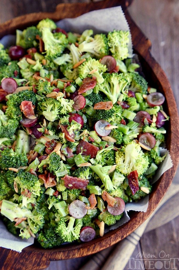 Cold Broccoli Salad recipe is bursting with flavor! Packed full of broccoli, bacon, grapes, almonds and more - every bite is delicious! The perfect addition to any BBQ, party, or potluck! // Mom On Timeout