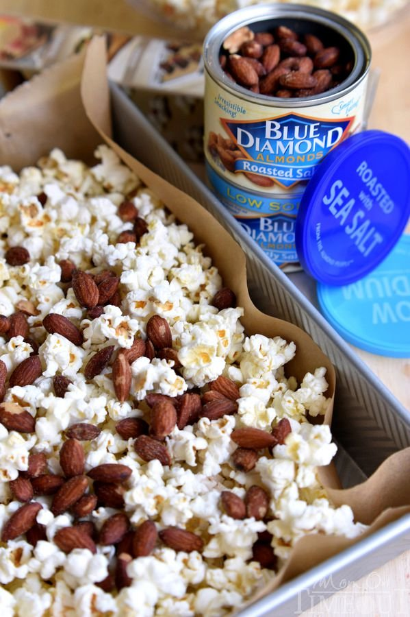 Welcome to your new favorite snack - Salted Caramel Popcorn with Almonds! Perfect for parties, road trips, family movie night and more! | MomOnTimeout.com