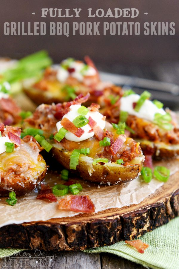 Too hot to cook indoors? Make these Fully Loaded Grilled BBQ Pork Potato Skins tonight! Fun enough for an appetizer yet hearty enough for a main dish, this delicious recipe is cooked straight on the grill and is perfect for all of your summer time entertaining! | MomOnTimeout.com | #recipe #appetizer #game #ad
