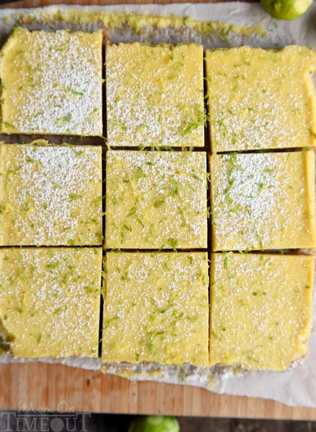 key lime bars on cutting board cut into squares