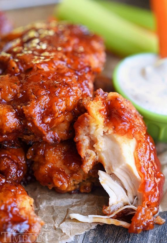 Sticky sweet Honey BBQ Chicken Strips are perfect for dinner or game day! Marinated in buttermilk and perfectly seasoned, these strips are hard to resist! | MomOnTimeout.com