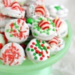 dipped oreo cookies decorated for chirstmas on green cake stand