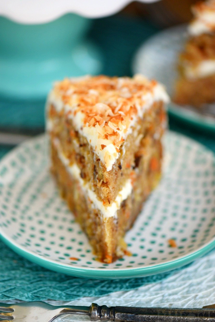 This Slow Cooker Carrot Cake with Cream Cheese Frosting is going to change your life! Free up the oven and get the moistest carrot cake you've ever had - right from your slow cooker! Made without oil or butter and loaded with coconut, pineapple and pecans!