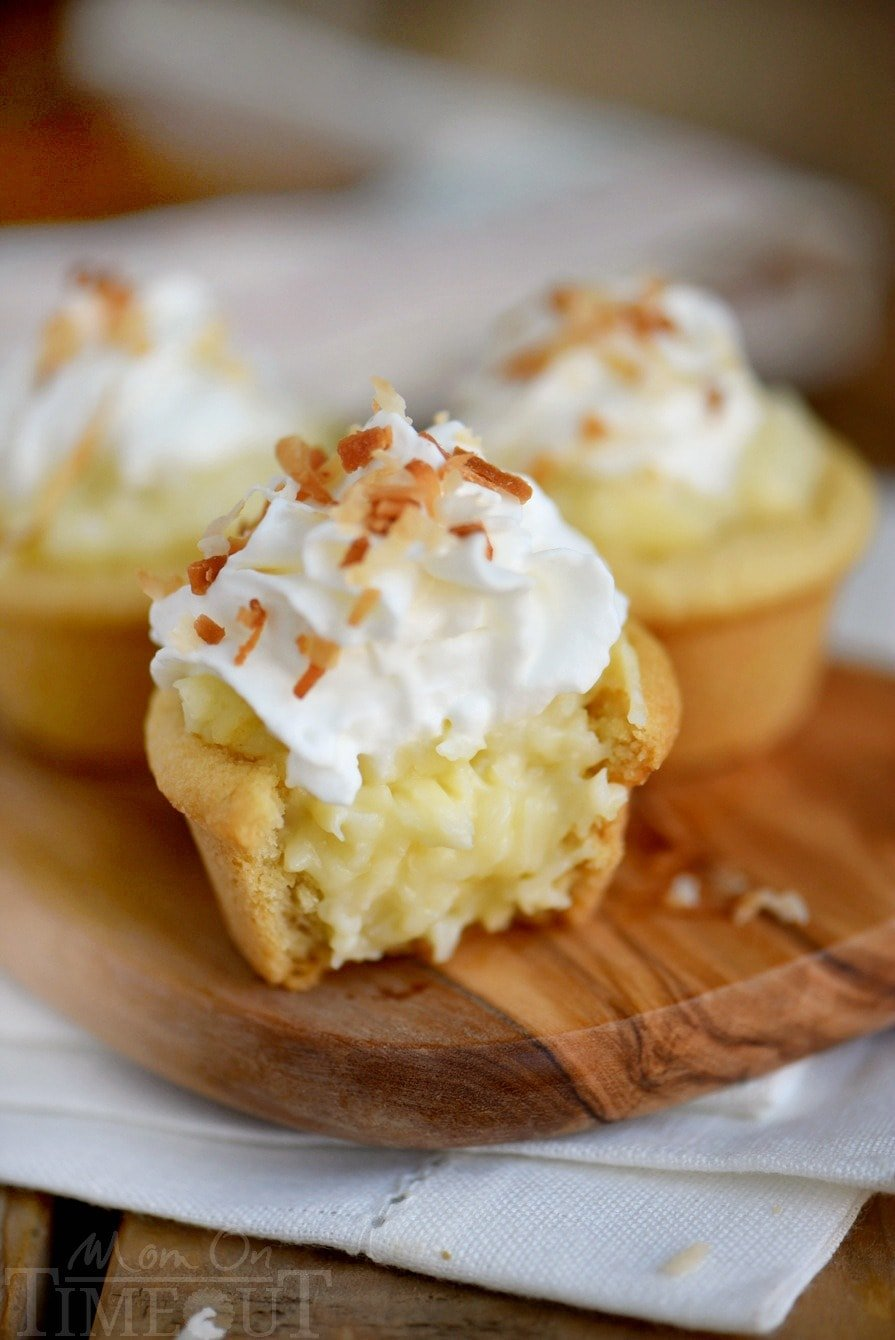 Coconut Cream Pie Cookie Cups! Two of my favorite desserts collide in this easy to make recipe that will have your guests oohing and aahing in no time!