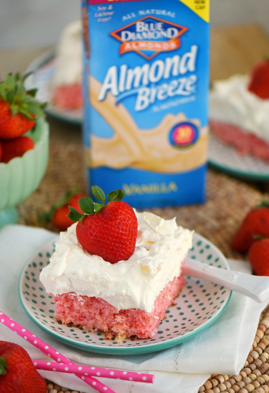 This Easy Strawberry Pineapple Cake recipe is perfect for all Spring and Summer festivities! Delightfully easy to make and topped with the creamiest pineapple fluff frosting, this cake will quickly become your go-to dessert recipe!