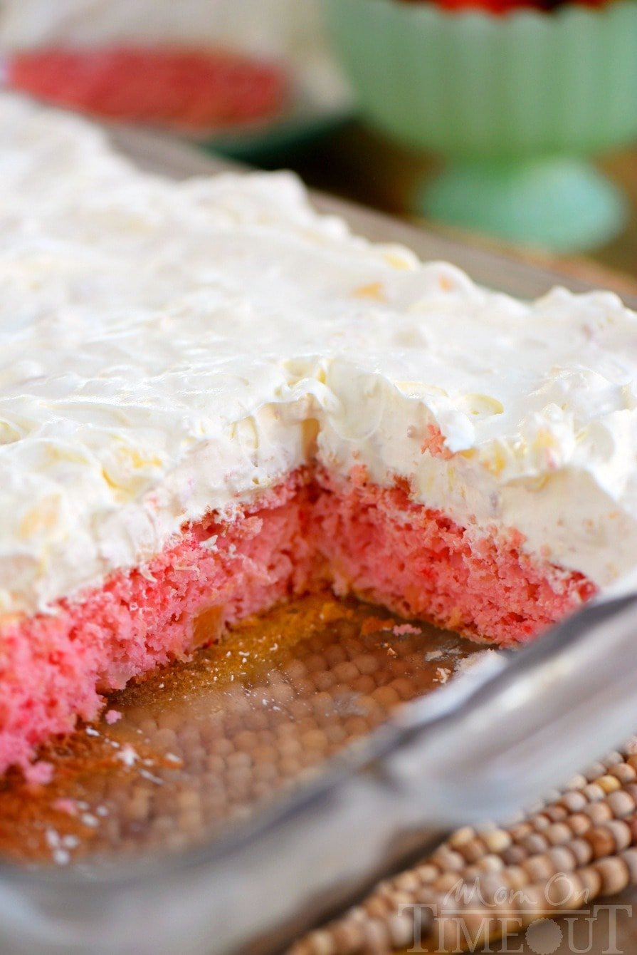 This Easy Strawberry Pineapple Cake is ideal for all Spring and Summer festivities! Delightfully easy to make and topped with the creamiest pineapple fluff frosting, this cake will quickly become your go-to dessert recipe!