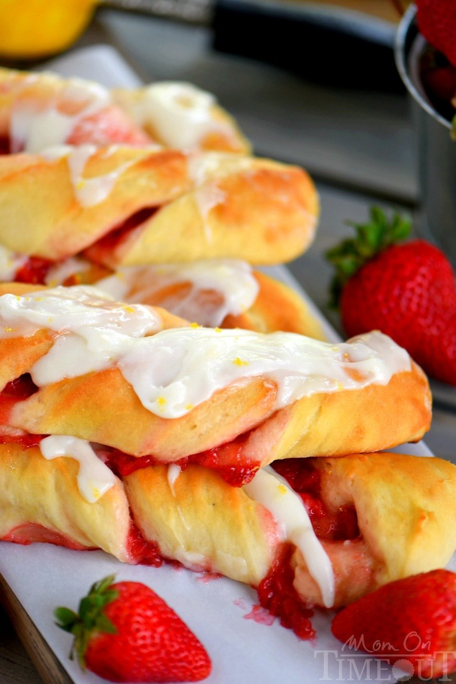 Strawberry Twists with Lemon Cream Cheese Glaze are sure to become your new favorite addition to Sunday brunch! A homemade strawberry filling makes these twists extra special and delicious and the lemon cream cheese glaze is going to knock your socks off!   Mom On Timeout
