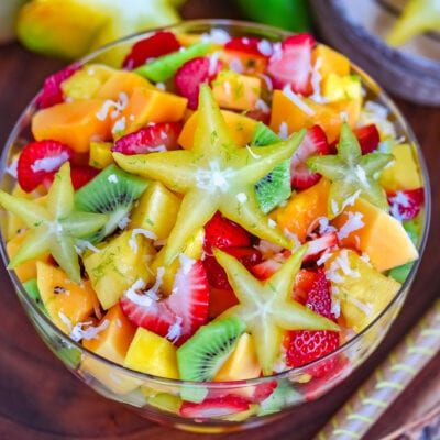 top down look at fruit salad with a star fruit right on top.