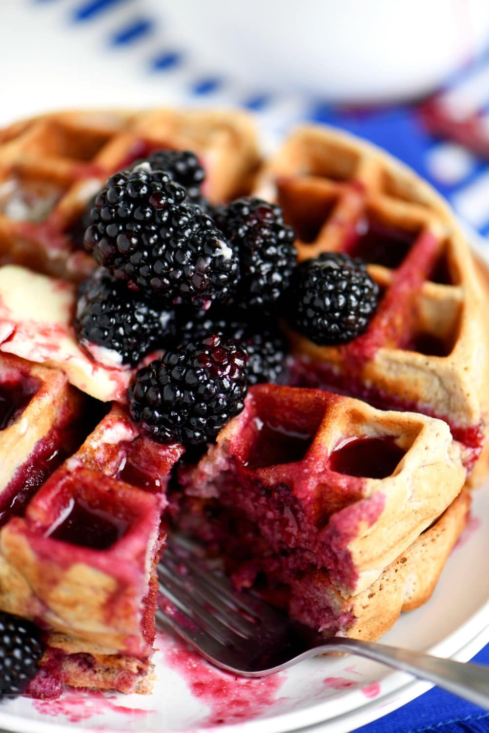 Better-for-you Overnight Blackberry Yeast Waffles with blackberry syrup - breakfast has never looked so good! Five minutes of work the night before delivers the most amazingly delicious waffles the next morning!
