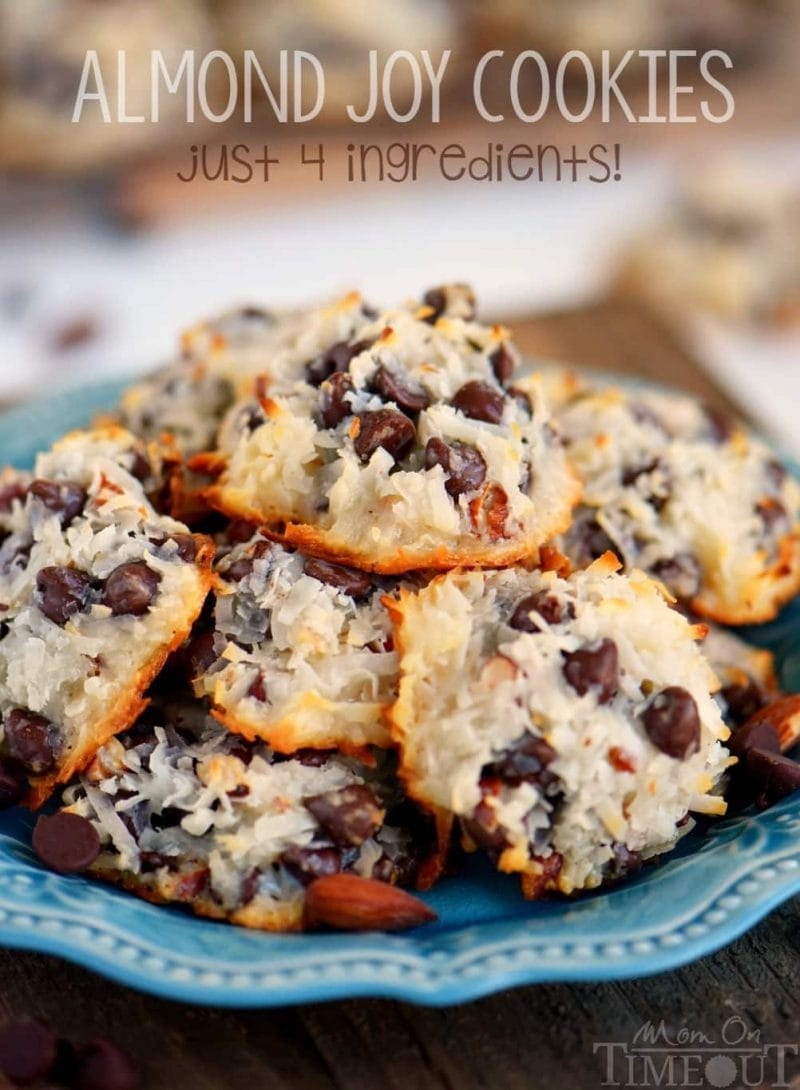 almond joy cookies piles high on a blue plate with title overlay at top