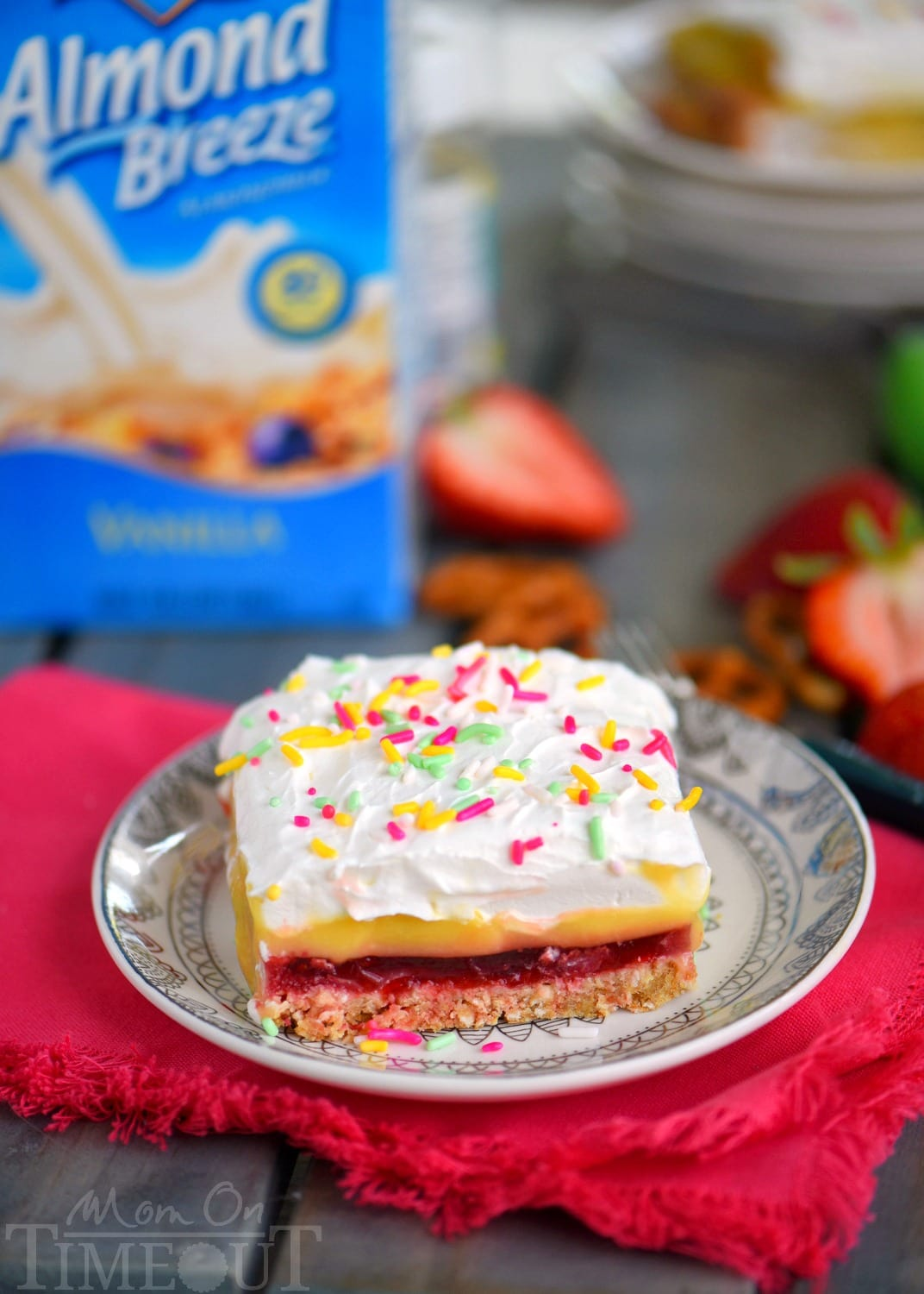 This easy No Bake Strawberry Pretzel Layered Dessert is sure to become a new family favorite! A graham cracker-pretzel crust is topped with a sweet strawberry jell-o layer, rich vanilla pudding and creamy whipped topping! Don't forget the sprinkles!