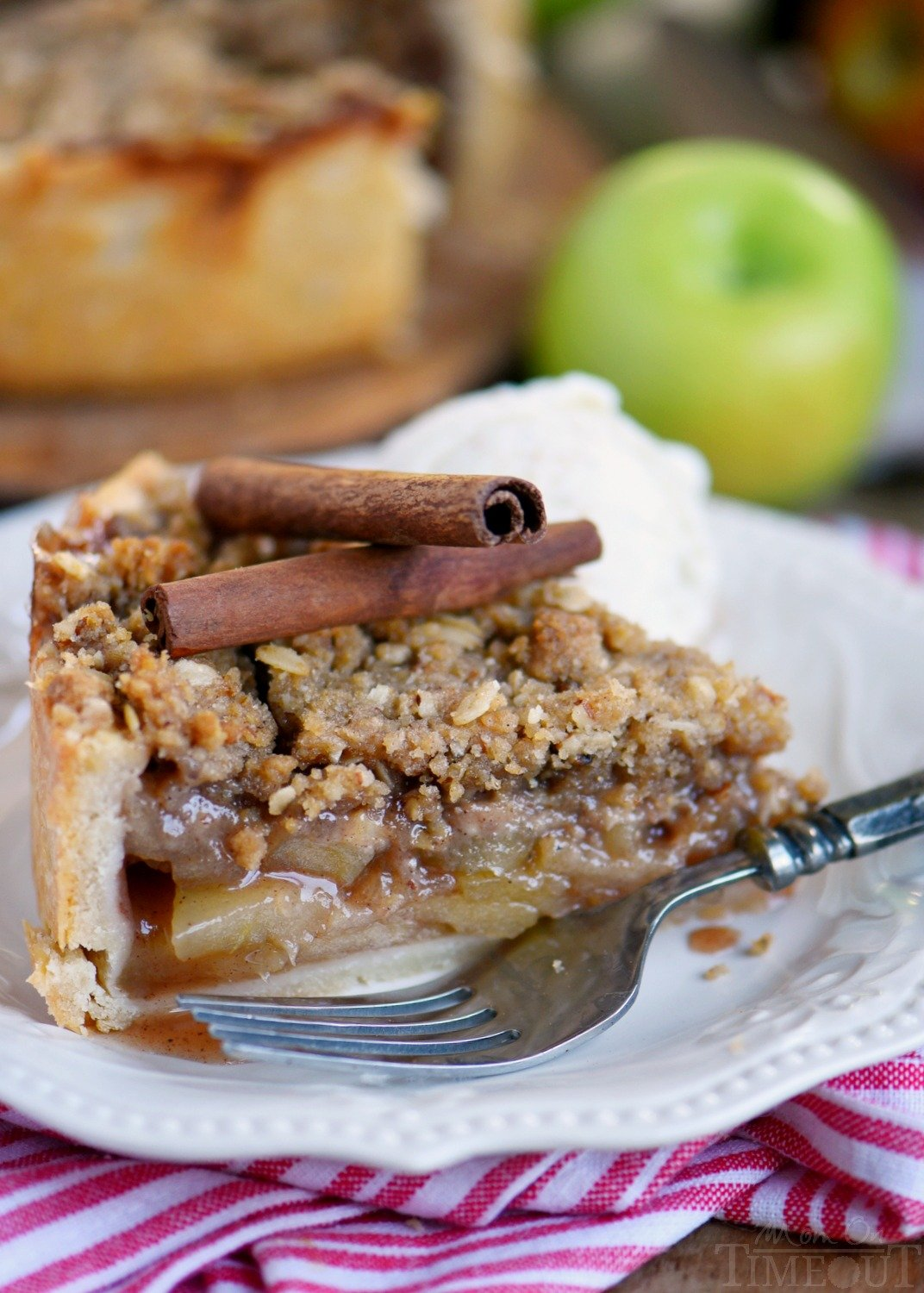 Deep Dish Dutch Apple Pie is loaded with a spiced apple filling and topped with a crunchy, sweet, pecan streusel topping. Best served with a big scoop of vanilla ice cream and caramel sauce. This is THE dessert for the fall season! | Mom On Timeout