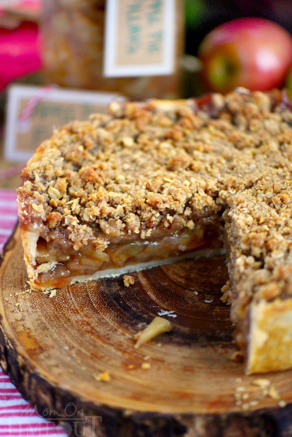 Deep Dish Dutch Apple Pie is loaded with a spiced apple filling and topped with a crunch, sweet, pecan streusel topping. Best served with a big scoop of vanilla ice cream and caramel sauce. This is THE dessert for the fall season! | Mom On Timeout